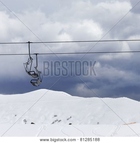 Chair Lifts And Off-piste Slope At Windy Gray Day