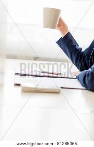 Businesswoman Taking A Well Earned Coffee Break