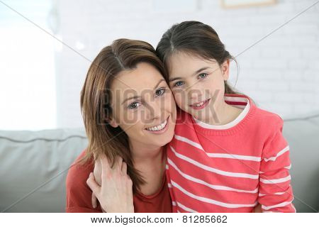 Portrait of mother and daughter with red shirt