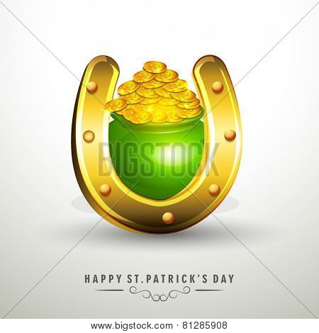 Irish lucky Day, St. Patrick's Day celebration with golden horseshoe, green earthenware and gold coins on grey background.