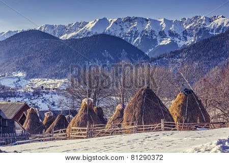 Farm With Haystacks In Winter