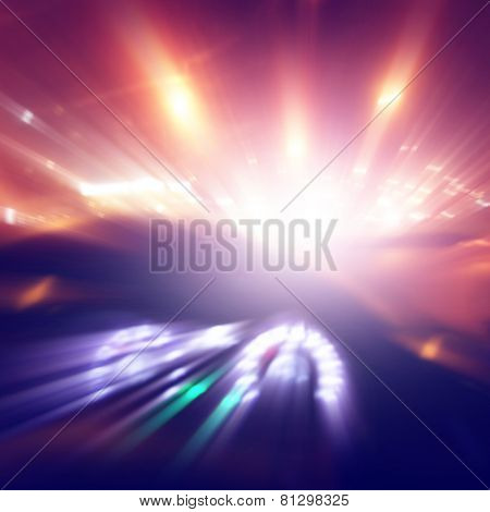 Car driving fast at sunset. Blurred motion image.