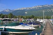 stock photo of annecy  - boats moored on Lake Annecy in France - JPG