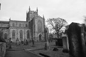 image of graveyard  - An exterior view across a graveyard toward the abbey church at Dunfermline - JPG