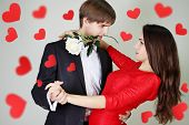 stock photo of tango  - Young beautiful couple dancing tango with a rose