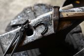 picture of anvil  - Color shot with a hammer a horse shoe and an anvil - JPG