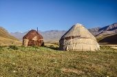 picture of yurt  - Nomadic settlements with yurts on green grasslands in Kyrgyzstan - JPG