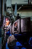 stock photo of welding  - Man welding with reflection of sparks on visor - JPG