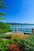 stock photo of tatas  - Flowers and lake in Tata in summer - JPG