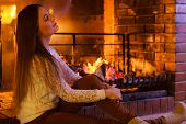 stock photo of cozy hearth  - Winter at home heating - JPG