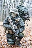 foto of raid  - Jagdkommando soldier Austrian special forces equipped with Steyr assault rifle during the raid