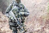 stock photo of raid  - Jagdkommando soldier Austrian special forces equipped with Steyr assault rifle during the raid