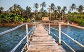 stock photo of wooden shack  - Wooden bridge to restaurant and resort in Goa India - JPG