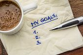 stock photo of goal setting  - my goals list on a napkin with cup of coffee - JPG