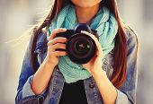 stock photo of  photo  - Young photographer taking photos outdoors - JPG