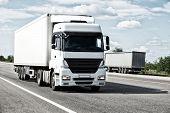 pic of trucks  - White truck on road - JPG