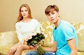 picture of sweetheart  - Young man giving flowers to his sweetheart - JPG