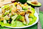 Постер, плакат: Salad seafood and avocado on napkin