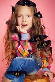 pic of black pants  - Studio portrait of a little girl with brown eyes and long curly hair - JPG