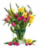picture of bosoms  - bunch  of pink tulip flowers and yellow daffodils in glass  vase isolated on white background - JPG