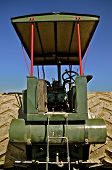 picture of threshing  - A view of a a restored antique steam engine from the back side exposes the huge steel wheels - JPG