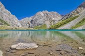 pic of crystal clear  - Crystal clear lake in mountain range Tien - JPG