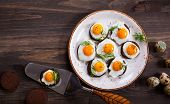 stock photo of canapes  - Preparation quail egg canapes with pumpernickel bread for Easter - JPG