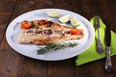 stock photo of pangasius  - Dish of Pangasius fillet with spices and vegetables on plate and wooden table background - JPG