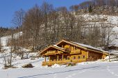 picture of chalet  - Winter scenery with wooden chalet on a sunny day in Magura village Brasov county Romania - JPG