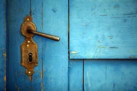 pic of levers  - Color shot of a vintage door handle on a wooden blue door. ** Note: Soft Focus at 100%, best at smaller sizes - JPG