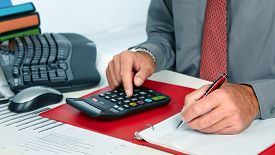 picture of calculator  - Hands of accountant business man with calculator - JPG