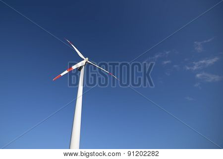 Wind Turbine With A Blue Sky