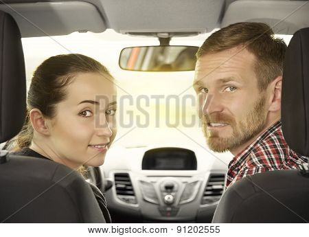 Couple Sitting In A Car.