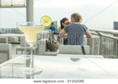 Margarita Cocktail On Table In Rooftop Bar