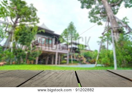 Defocused And Blur Image Of Terrace Wood And Beautiful Home For