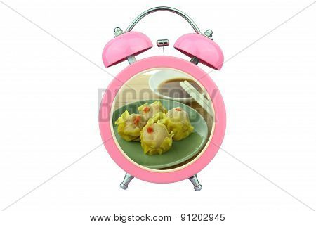 Conceptual Art : Shu Mai Time : Shu Mai And Sauce Within Pink Alarm Clock Isolated On White Backgrou