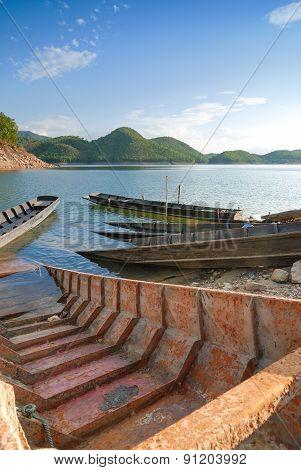 Empty Boat Standing At Pier Under Bright Sunlight