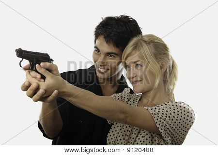 man teaches woman about guns