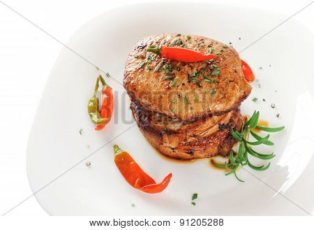 Steak With Rosemary And Chili Pepper On A Plate