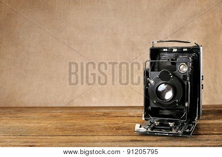 Vintage Plate-camera On A Wooden Table.