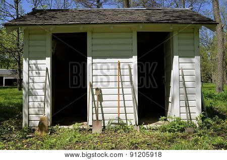 Garden shed with two open doors