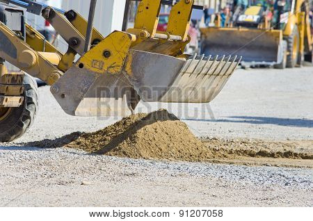 Bulldozer Bucket Collecting Sand