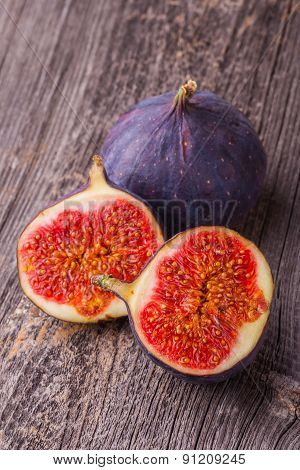 Ripe Figs On The Wooden Table