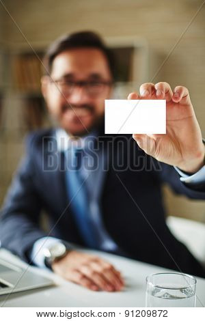 Hand of businessman with blank card introducing himself to partner