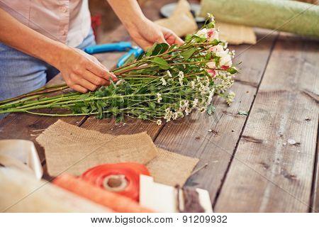 Hands of female florist working in studio