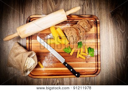 Bread baking set on wooden background