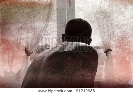 Abstract image of a man by the window