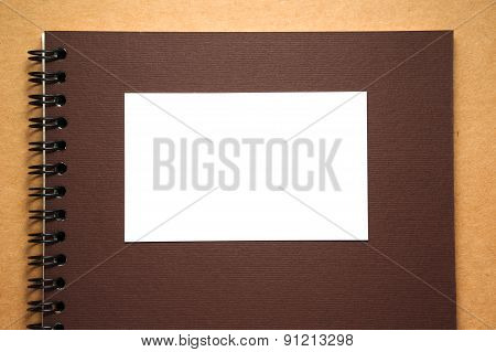 Blank White Paper On Notebook