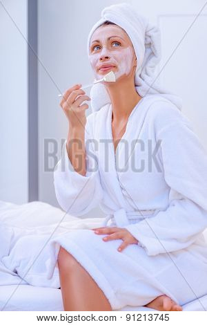 home anti-aging programm applying mask