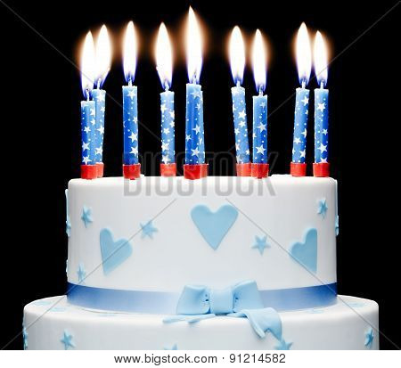 Birthday Cake With Lit Up Candles On Black Background